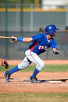Texas Rangers minor league outfielder Eduard Pinto #32 during an instructional league game against a Korean All-Star team at the Surprise Stadium Complex on October 13, 2012 in Surprise, Arizona.  (Mike Janes/Four Seam Images)