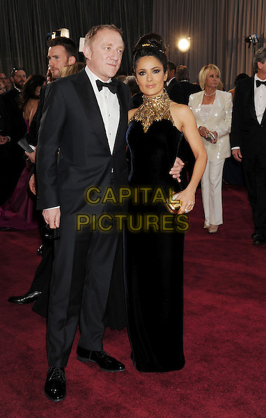 Francois-Henri Pinault, Salma Hayek (wearing McQueen).85th Annual Academy Awards held at the Dolby Theatre at Hollywood & Highland Center, Hollywood, California, USA..February 24th, 2013.oscars full length black dress tuxedo white shirt bow tie white clutch bag married husband wife gold embellished jewel encrusted high collar sleeveless .CAP/ROT/TM.©Tony Michaels/Roth Stock/Capital Pictures