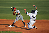Brevard County Manatees second baseman Fidel Pena (18) throws to first base as Wade Hinkle (25) slides in during a game against the Lakeland Flying Tigers on April 19, 2016 at Henley Field in Lakeland, Florida.  Lakeland defeated Brevard County 9-2.  (Mike Janes/Four Seam Images)