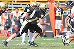 Palos Verdes, CA 09/22/11 - Triston Martinez (Peninsula #70)) in action during the Beverly Hills-Peninsula Varsitty Football gane.