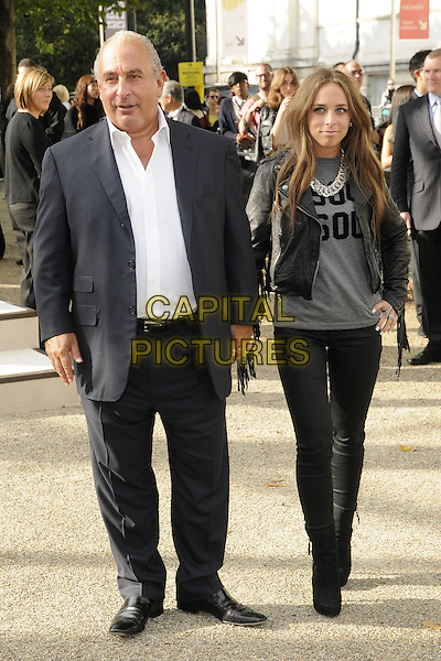 SIR PHILIP GREEN & CHLOE GREEN .attending the Burberry Prorsum Spring Summer Collection, during London Fashion Week at the Chelsea College of Art and Design, London, England, UK, September 21st 2010. .LFW show full length white shirt grey gray top silver necklace black leather jacket jeans ankle boots father dad family daughter holding hands suit .CAP/CAN.©Can Nguyen/Capital Pictures.