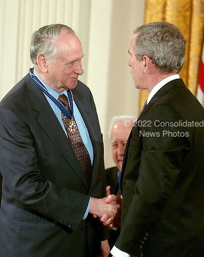 Washington, D.C. - December 15, 2006 -- William Safire receives the Presidential Medal of Freedom  from United States President George W. Bush and first lady Laura Bush during a ceremony in the East Room of the White House on Friday, December 15, 2006.  The medal is the nation's highest civil award.  It may be awarded &quot;to any person who has made an especially meritorious contribution to (1) the security or national interests of the United States, or, (2) world peace, or (3) cultural or other significant public or private endeavors&quot;.  As a journalist, speechwriter, columnist, author, and lexicographer, William Safire has distinguished himself as one of our country's most talented writers and commentators.  Using the power of prose, he has educated our citizenry, polished our language, and vigorously defended human freedom.  His work has earned him the recognition of his peers, including the Pulitzer Prize for Distinguished Commentary, and has elevated debate on issues of the day.  The United States honors William Safire for his uncompromising commitment to his craft and to strengthening our democracy.<br /> Credit: Ron Sachs / CNP