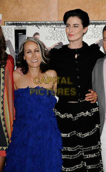 CARYN FRANKLIN, ERIN O'CONNOR .At The Clothes Show London, Excel centre, Royal Victoria Dock, London, England, UK, May 29th 2009..half length blue strapless dress ruffles black top skirt cardigan buttons .CAP/CAN.©Can Nguyen/Capital Pictures