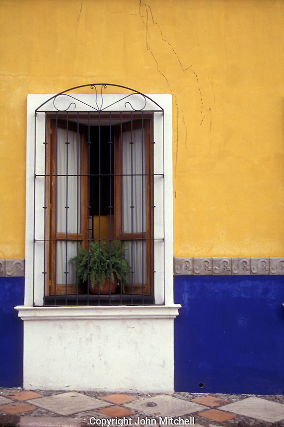 Window of a reatored colonial house in the city of Colima, Mexico