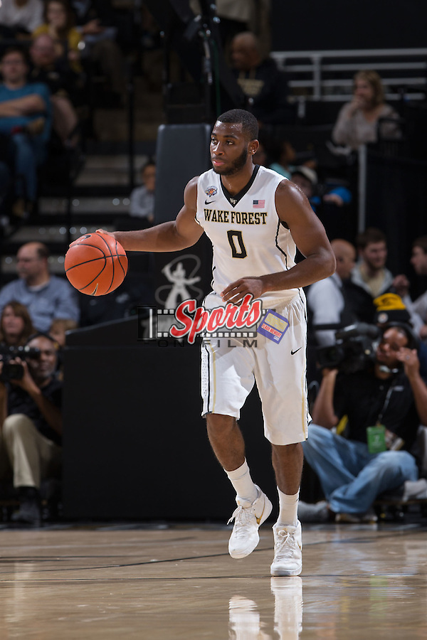 Codi Miller-McIntyre (0) of the Wake Forest Demon Deacons brings the ball up the court during first half action against the Xavier Musketeers at the LJVM Coliseum on December 22, 2015 in Winston-Salem, North Carolina.  The Musketeers defeated the Demon Deacons 78-70.  (Brian Westerholt/Sports On Film)