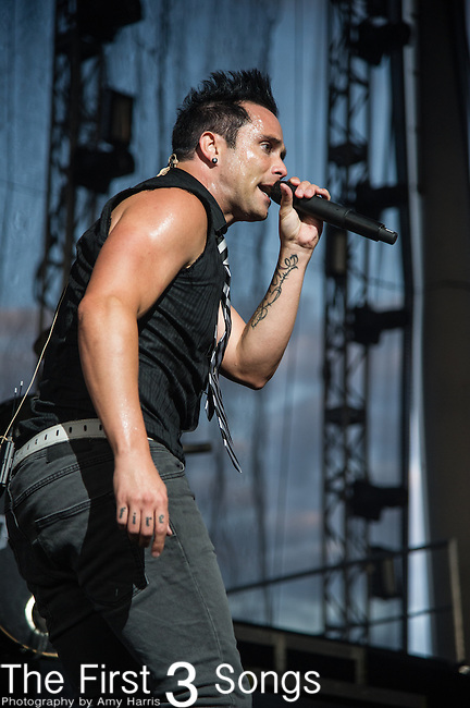 John Cooper of Skillet performs during the Carnival of Madness at Jacobs Pavilion at Nautica in Cleveland, Ohio.