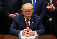 United States President Donald Trump pauses after signing the S. 544 the Veterans Choice Program Extension and Improvement Act in the Roosevelt Room at the White House in Washington, DC on April 19, 2017.<br /> CAP/MPI/CNP/RS<br /> &copy;RS/CNP/MPI/Capital Pictures