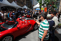 Montreal (QC) CANADA - June 7, 2012 - Crowd and Expensive cars  on Peel street in downtown Montral during the Formula One Grand-Prix week end.