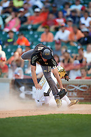 Brenden Heiss (42) of Jacobs High School in Lake in the Hills, Illinois jumps over a sliding Austin James (23) to catch a high throw while covering home during the Under Armour All-American Game on August 15, 2015 at Wrigley Field in Chicago, Illinois. (Mike Janes/Four Seam Images)