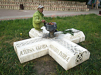 Romania. Iași County. Iasi. A homeless man is seated on a marble stone and cooks meat from gas coming out the urn. The following words are written on the stone: Eternal glory to fatherland's heroes. Iași (also referred to as Iasi, Jassy or Iassy) is the largest city in eastern Romania and the seat of Iași County. Located in the Moldavia region, Iași has traditionally been one of the leading centres of Romanian social life. The city was the capital of the Principality of Moldavia from 1564 to 1859, then of the United Principalities from 1859 to 1862, and the capital of Romania from 1916 to 1918. 6.06.15 © 2015 Didier Ruef