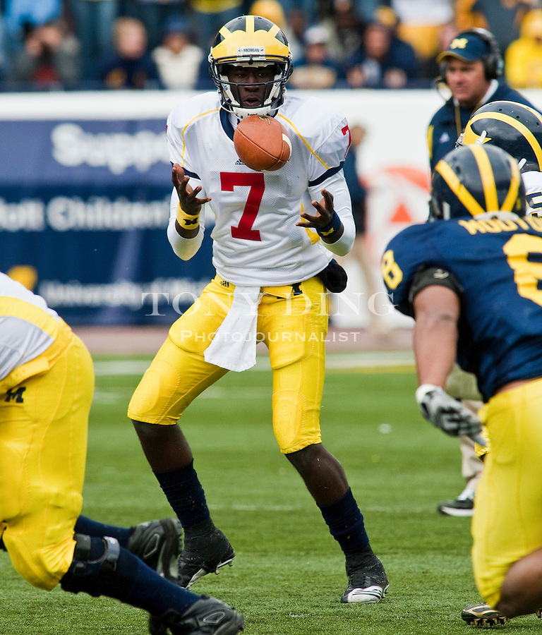 Michigan quarterback Devin Gardner (7) juggles the football after the snap during the Wolverines' spring football game, Saturday, April 17, 2010, in Ann Arbor, Mich. (AP Photo/Tony Ding)