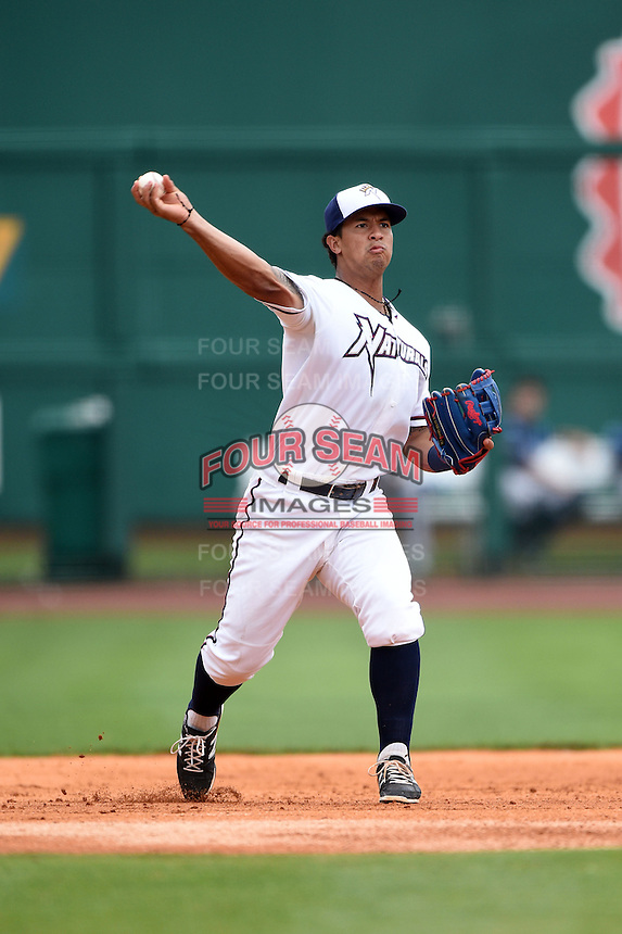 NW Arkansas Naturals third baseman Cheslor Cuthbert (11) throws to first during a game against the Corpus Christi Hooks on May 26, 2014 at Arvest Ballpark in Springdale, Arkansas.  NW Arkansas defeated Corpus Christi 5-3.  (Mike Janes/Four Seam Images)