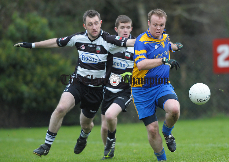Jamie O Connor of Clarecastle in action against Colm Davoren of Michael Cusack's during their Junior A football final at Corofin. Photograph by John Kelly.