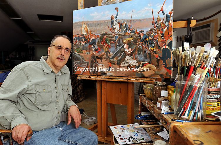 SOUTHBURY, CT, 27 JUNE 2011-062711JS03-- Civil War expert and Revolutionary War artist Don Troiani sits in front of his unfinished painting of the Battle of Fort Washington depicting the wounding of Margaret Corbin in 1776, inside his Southbury home studio. <br /> Jim Shannon/Republican-American