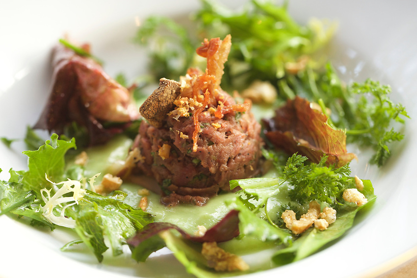 New York, NY - May 20, 2016: Laap Dip Neua, a Northern Thai beef tartare, topped with crispy offal at a special dinner at Mountain Bird in East Harlem. Hosted by chefs Kenichi Tajima and Andy Ricker, this was one of the many Dine In Harlem meals served during Harlem Eat Up!<br /> <br /> <br /> CREDIT: Clay Williams for Food Republic.<br /> <br /> &copy; Clay Williams / claywilliamsphoto.com