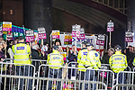 "© Joel Goodman - 07973 332324 . 03/11/2017 . Manchester , UK . Counter protest organised by Unite Against Fascism . Fans of Tommy Robinson (real name Stephen Yaxley-Lennon ) and anti-fascist counter demonstrators at the launch of the former EDL leader's book "" Mohammed's Koran "" at Castlefield Bowl . Originally planned as a ticket-only event at Bowlers Exhibition Centre , the launch was moved at short notice to a public location in the city . Photo credit : Joel Goodman"