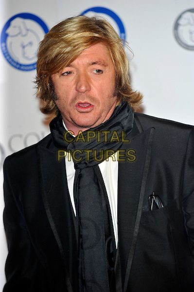 Nicky Clarke.Attending the Battersea Dogs & Cats Home 'Collars & Coats Gala Ball 2012' held at Battersea Evolution, London, England, UK, 8th November 2012 .portrait headshot scarf grey gray jacket black mouth open funny .CAP/CJ.©Chris Joseph/Capital Pictures.