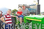 Little Sean O'Donoghue with his dad Tim and grandfather Sean Walsh on a John Deere at the South Kerry Ploughing Championships in Fossa on Sunday