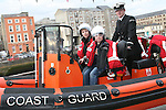 Cormac and Donnachadh Stott in the Coastguard boat at Scotch Hall...Photo NEWSFILE/Jenny Matthews.(Photo credit should read Jenny Matthews/NEWSFILE)....This Picture has been sent you under the condtions enclosed by:.Newsfile Ltd..The Studio,.Millmount Abbey,.Drogheda,.Co Meath..Ireland..Tel: +353(0)41-9871240.Fax: +353(0)41-9871260.GSM: +353(0)86-2500958.email: pictures@newsfile.ie.www.newsfile.ie.FTP: 193.120.102.198.