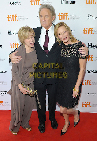 Kevin Kline, JoBeth Williams, Mary Kay Place<br /> &quot;The Big Chill&quot; 30th Anniversary Screening held at Princess of Wales Theatre, Toronto, Ontario, Canada.<br /> September 5th, 2013<br /> TIFF full length black lace dress suit brown arms over shoulders<br /> CAP/ADM/BPC<br /> &copy;Brent Perniac/AdMedia/Capital Pictures