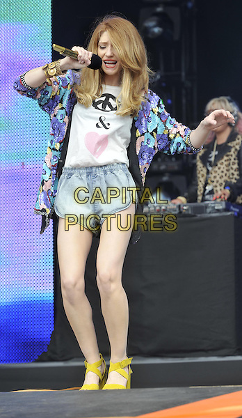 Nicola Roberts.Sainsburys Super Saturday at Clapham Common, London, England..September 10th 2011.stage concert live gig performance music full length blue faded jean denim shorts jacket purple turquoise floral print jacket yellow sandals singing dancing arm.CAP/ROS.©Steve Ross/Capital Pictures