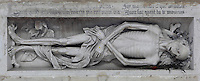 High relief of an anonymous corpse, 1530, in the Chapel of Saint Claude in the side aisle of the Collegiate Church of Saint-Gervais-Saint-Protais, built 12th to 16th centuries in Gothic and Renaissance styles, in Gisors, Eure, Haute-Normandie, France. The corpse is accompanied by inscriptions in Latin and French, warning that we will all be like this one day and to make the most of life. The church was consecrated in 1119 by Calixtus II but the nave was rebuilt from 1160 after a fire. The church was listed as a historic monument in 1840. Picture by Manuel Cohen