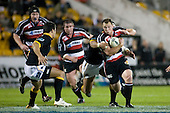 Kevin Farrell tries to evade the tackle of Serge Lilo as he lines up Shannon Paku. Air New Zealand Cup rugby game between Counties Manukau Steelers & Wellington played at Mt Smart Stadium on the 31st August 2007. The Score was 13 all at halftime, with Wellington going on to win 33 - 18.