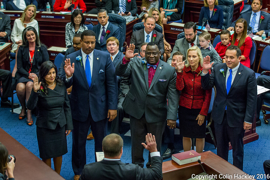 TALLAHASSEE, FLA. 11/22/16-Rep. Jackie Toledo, R-Tampa, left, Rep. Sean Shaw, D-Tampa, Rep. Wengay M. &quot;Newt&quot; Newton, Sr., D-St. Petersburg, Rep. Alexandra Miller, R-Sarasota, and Rep. Ben Diamond, D-St. Petersburg take the oath of office from Judge Nicholas Thompson during the organizational session of the legislature at the Capitol in Tallahassee.<br /> <br /> COLIN HACKLEY PHOTO