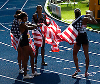 23 AUG 2009 - BERLIN, GER - The American team celebrate their victory in the Womens 4 x 400m final at the World Athletics Championships (PHOTO (C) NIGEL FARROW)