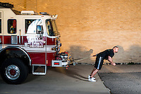 World's Strongest Man Brian Shaw (cq) pulls a fire truck in Ft. Lupton, Colorado, Tuesday, October 8, 2013. <br /> <br /> Photo by Matt Nager
