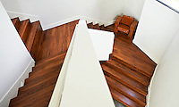 Distorted view down the contemporary wooden staircase