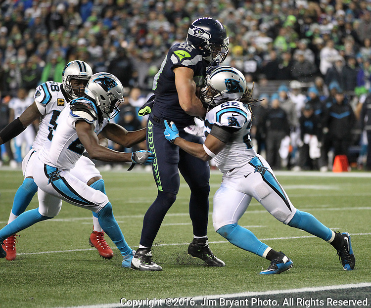Seattle Seahawks tight end Jimmy Graham (88) is tackled at the one-yard line by Carolina Panthers cornerback James Bradberry (24) and Carolina Panthers free safety Michael Griffin (22) at CenturyLink Field in Seattle, Washington on December 4, 2016.  Graham caught six passes for 63 yards and scored one touchdown in the Seahawks 40-7 win over the Panthers.    ©2016. Jim Bryant photo. All Rights Reserved.