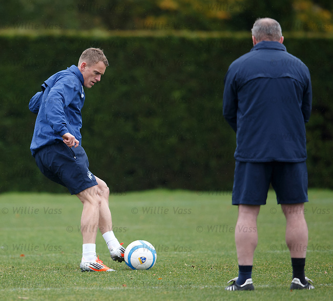 Dean Shiels being watched carefully by Ally McCoist