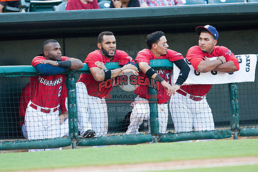 Oklahoma City RedHawks players Ruben Sosa, Jonathan Villar and Ronald Torreyes watch from the dugout during the Pacific League game against the Colorado Springs Sky Sox at the Chickasaw Bricktown Ballpark on August 3, 2014 in Oklahoma City, Oklahoma.  The RedHawks defeated the Sky Sox 8-1.  (William Purnell/Four Seam Images)