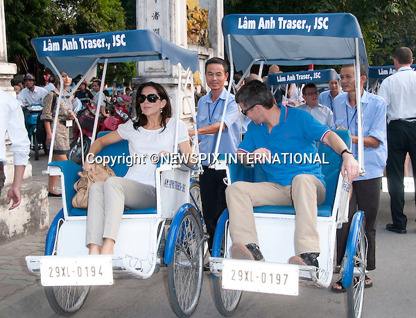 """CROWN PRINCESS MARY AND CROWN PRINCE FREDERIK.take a cyclo tour in a rickshaw in Hanoi, the capital of Vietnam..The Danish Royal Family took in the sights of Hanoi before the start of the State Visit to the Socialist Republic of Vietnam..Prince Henrik, The Prince Consort, showed his family his childhood home at 80 Phan Ding Phung before the start of the cyclo tour_01/11/2009.Mandatory Photo Credit: ©Dias/Newspix International..**ALL FEES PAYABLE TO: """"NEWSPIX INTERNATIONAL""""**..PHOTO CREDIT MANDATORY!!: NEWSPIX INTERNATIONAL(Failure to credit will incur a surcharge of 100% of reproduction fees)..IMMEDIATE CONFIRMATION OF USAGE REQUIRED:.Newspix International, 31 Chinnery Hill, Bishop's Stortford, ENGLAND CM23 3PS.Tel:+441279 324672  ; Fax: +441279656877.Mobile:  0777568 1153.e-mail: info@newspixinternational.co.uk"""