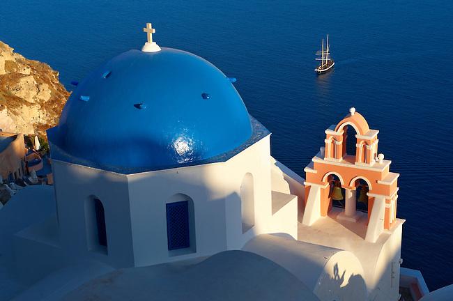 Oia, ( Ia ) Santorini - Blue domed Byzantine Orthodox churches, - Greek Cyclades islands