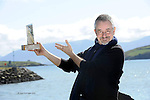 French Director Jean Jaques Beineix famed for 'Betty Blue' and many more movies pictured on Dingle pier in County Kerry on Friday after receiving the Gregory Peck Award for  For Excellence in the Art of Film  as part of the annual Dingle Film Festival which got under way last night.<br /> The locally designed award based on anOgham Stone recoqnises high achievers in the field of filmmaking, and celebrates the festival's friendship with The Gregory Peck Family.  The festival continues all weekend.<br /> Picture by Don MacMonagle