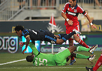 CHESTER, PA - AUGUST 12, 2012:  Sheanon Williams (25) of the Philadelphia Union flies over  Sean Johnson (25) of the Chicago Fire during an MLS match at PPL Park, in Chester, PA on August 12. Fire won 3-1.