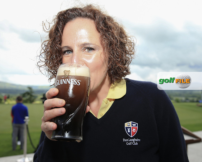 There's only one way to a successful event in Ireland; a club member downs a pint of the fine black Irish ale, at the Curtis Cup, played at Dun Laoghaire GC, Enniskerry, Co Wicklow, Ireland. 12/06/2016. Picture: David Lloyd | Golffile. <br /> <br /> All photo usage must display a mandatory copyright credit to &copy; Golffile | David Lloyd.