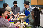 High School students attending after school enrichment cooking class taught by volunteer chef