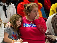 Sad Hillary Clinton supporters look on as the vote counts are announced during her Election Night Event at the Jacob K. Javits Convention Center in New York, New York on Tuesday, November 8, 2016.<br />