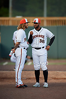 "Delmarva Shorebirds pitcher Juan Echevarria (38) ""interviews"" fellow pitcher Nick Vespi (26) before a South Atlantic League game against the Greensboro Grasshoppers on August 21, 2019 at Arthur W. Perdue Stadium in Salisbury, Maryland.  Delmarva defeated Greensboro 1-0.  (Mike Janes/Four Seam Images)"