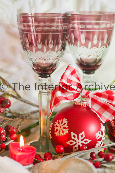 A pair of  wine glasses forms part of the Christmas still life on the coffee table