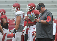 NWA Democrat-Gazette/MICHAEL WOODS &bull; @NWAMICHAELW<br /> University of Arkansas coach Bret Bielema watches the Razorbacks run drills during practice Saturday August 22, 2015 at Razorback Stadium in Fayetteville.