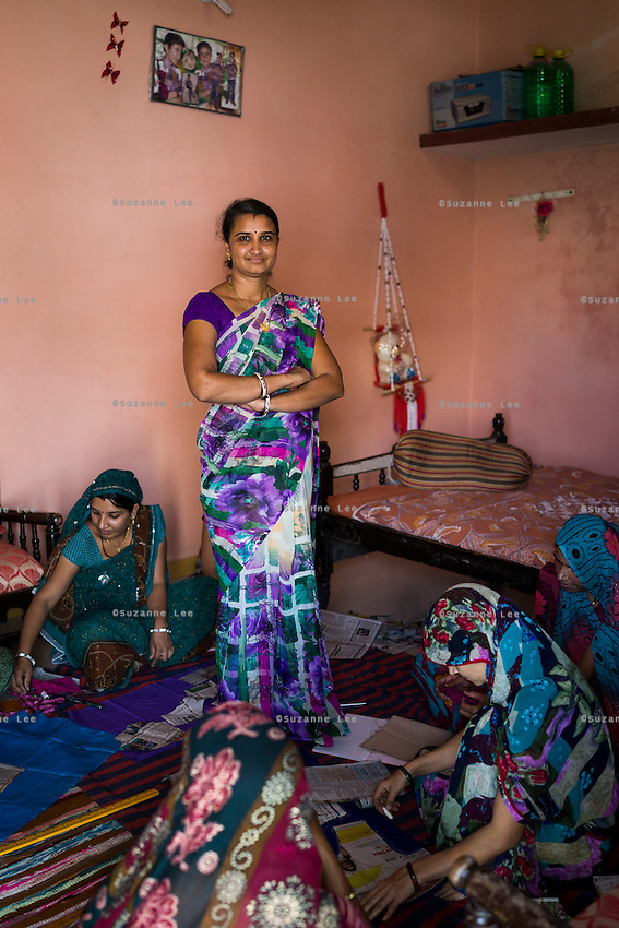Stitching teacher Kavita Yadav, 34, who is hired using the Fairtrade Premiums to teach women sewing, teaches her students in Maheshwar, Khargone, Madhya Pradesh, India on 13 November 2014. Kavita travels to a different village every few weeks to conduct the stitching course that is free for women, as she is funded using the Fairtrade Premiums from Fairtrade cotton farmers. Photo by Suzanne Lee for Fairtrade