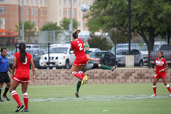 Denton, TX - AUGUST 31: Carly McDowell #4 of the North Texas Mean Green soccer in action against University of Houston Cougars at the Mean Green Village Soccer Field on August 31, 2012 in Denton, Texas. NT won 2-1.(Photo by Rick Yeatts)