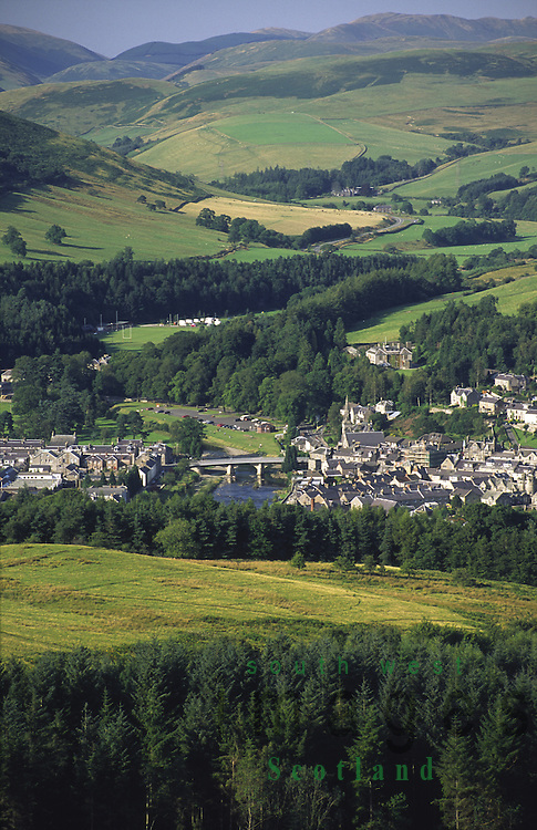 Looking down on the town of Langholm and Thomas Telfords Bridge in amoungest the border hills Scotland UK
