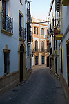 Historic buildings narrow Tenorio street in the old city, Ronda, Spain