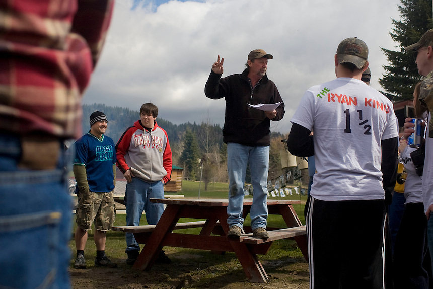 Master of Ceremonies giving rules and instructions at the 2011 Mud Volleyball Tournament in Laclede, ID sponsored by the Kodiak Bar. .(©Matt Mills McKnight/2011)