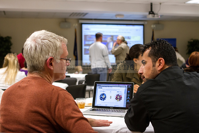 ESL instructor William McIlwain explains the election process to his student, Manhal Boya. in Lexington, Ky., on Tuesday, November, 6, 2012. Photo by James Holt | Staff
